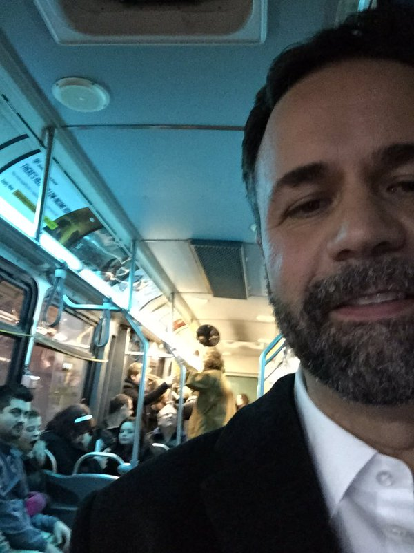 Don Vassiliadis, Chair of Transportation for City of Peterborough, riding a bus on New Year's Eve last year