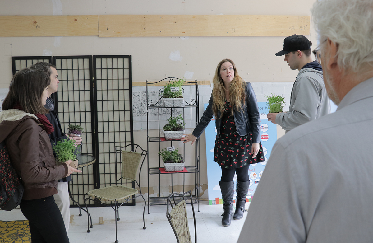 Tiny Bromley, owner of Tiny Greens, gives a tour of her new location at 431 George Street North.