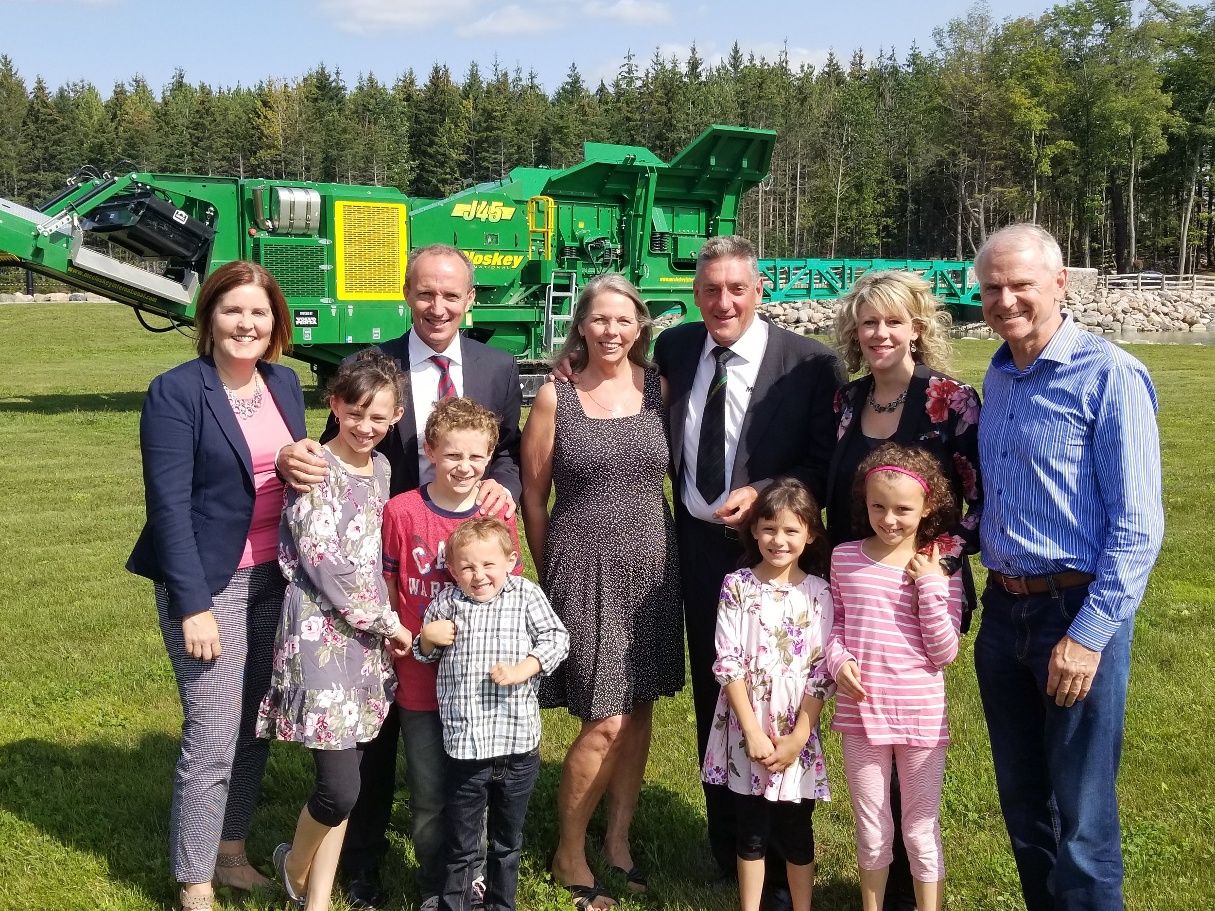 Left to right:  PRHC Foundation CEO Lesley Heighway, Donnell Leahy, Sylvia and Paschal McCloskey of McCloskey International, Natalie MacMaster and PRHC Foundation Governor Emeritus Terry Windrem join MacMaster and Leahy's children at the site of this weekend's Greenbridge Celtic Festival for a photo in celebration of the McCloskey's $1 million pledge to the PRHC Foundation.