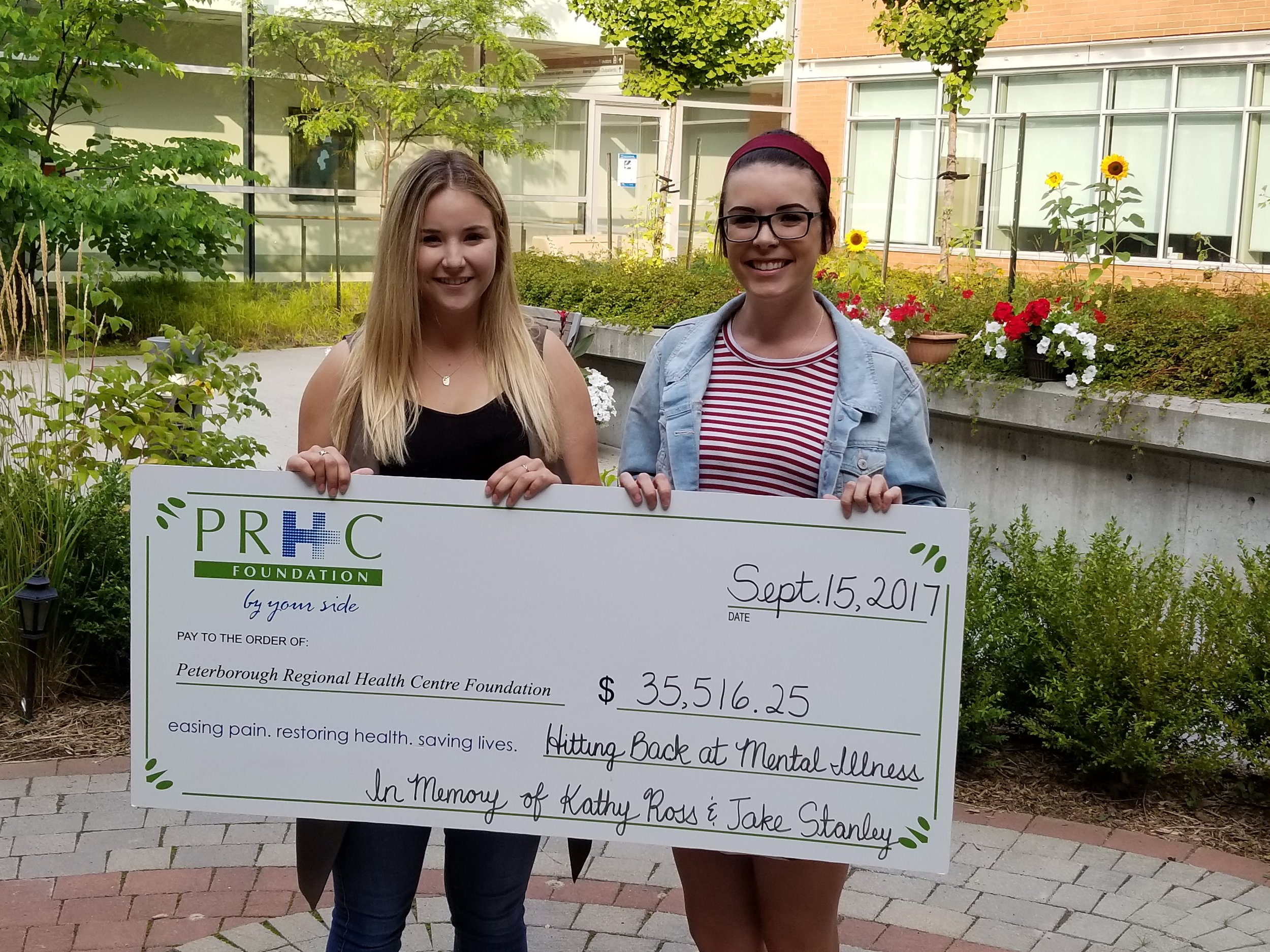 Brianna Hamilton and Sarah Ross presenting the cheque to PRHC