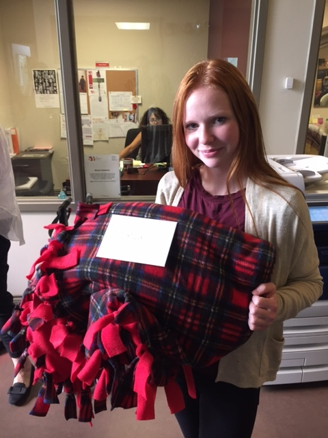 Faith Dickinson with her plaid fleece cuddle blankets at NCC