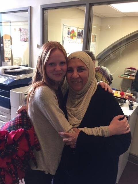 Faith and Hend Altech share a hug.