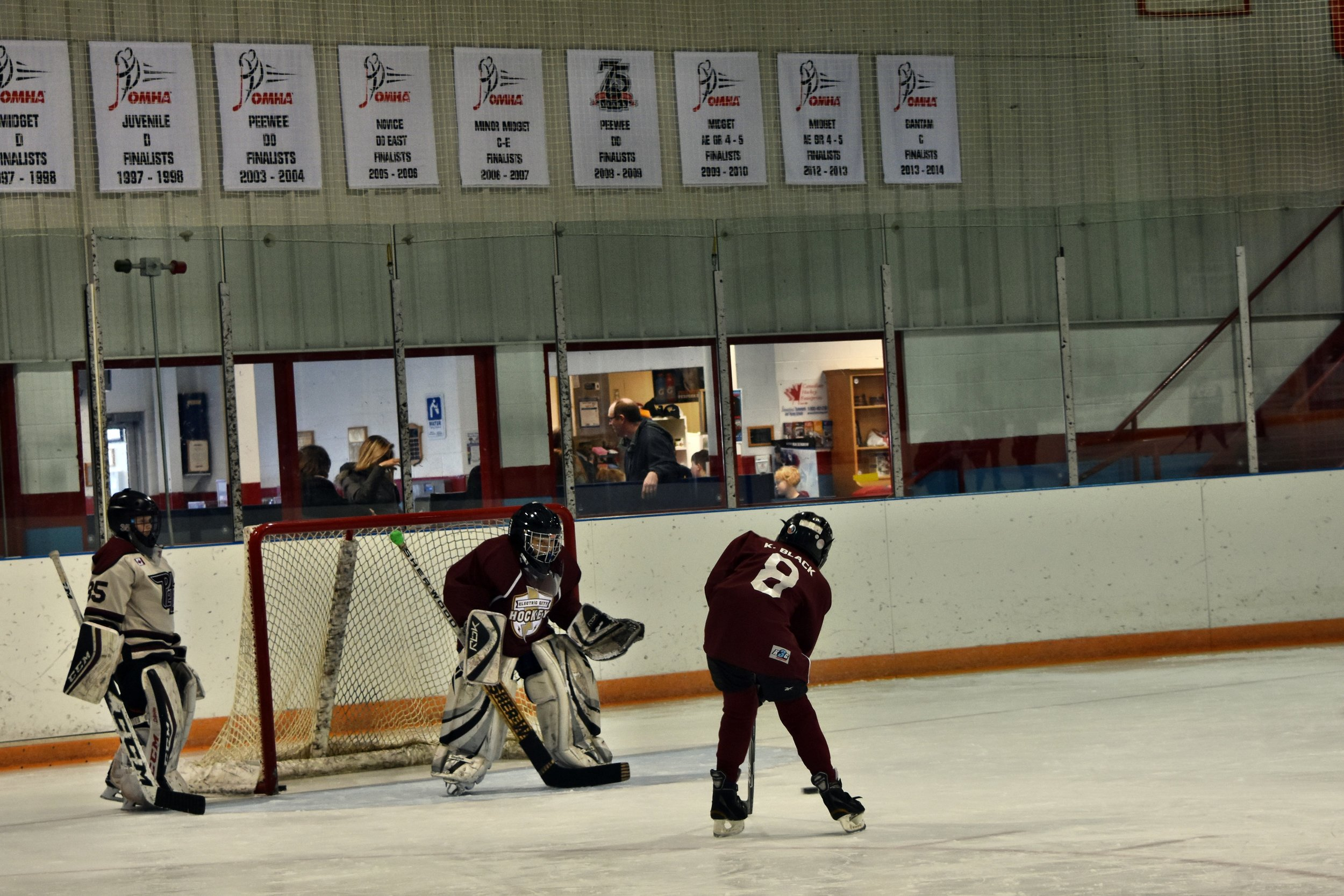 Brody (at left) giving advice to Jacob about goaltending