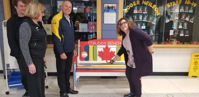 Ribbon Cutting of Rotary Buddy Bench at Roger Neilson School: (Left to Right) Nate Loch, Rotarian Donna Geary, Kawartha Club President Brian Prentice & Principal Denise Humphries