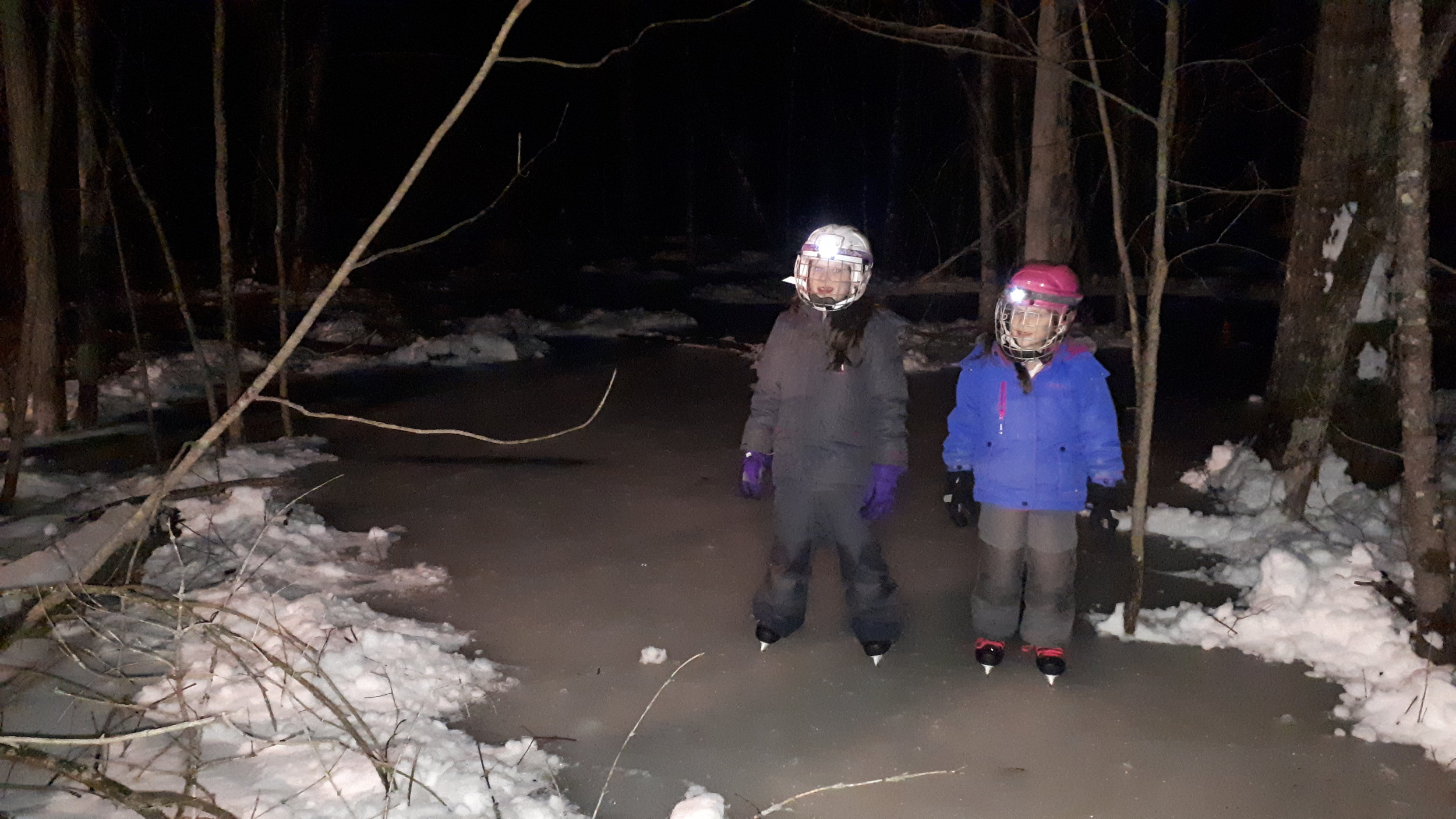 The kids enjoying night skate in forest