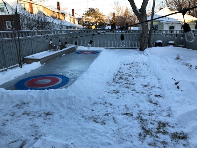 The rink was made on the opposite side of the yard from the pump track