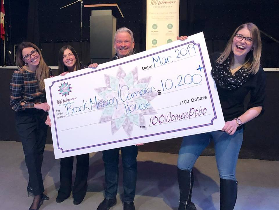Bill McNabb, Executive Director of Brock Mission Cameron House, accepting the cheque from 100 Women Co-Founders Catia Skinner, Alyssa Stewart and Rosalea Terry,