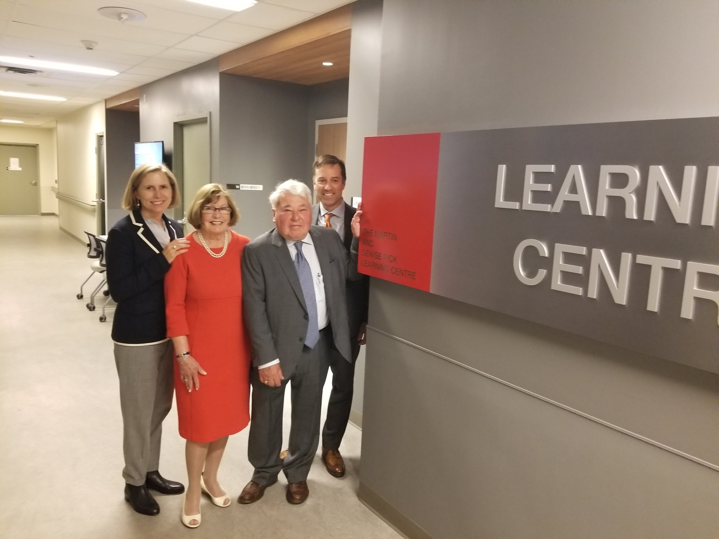 Members of the Pick Family pose at the entrance to the new Martin and Denise Pick Learning Centre that now bears their name.  From left:  Dr.Rardi van Heest, Denise Pick, Martin Pick and Charles Pick.