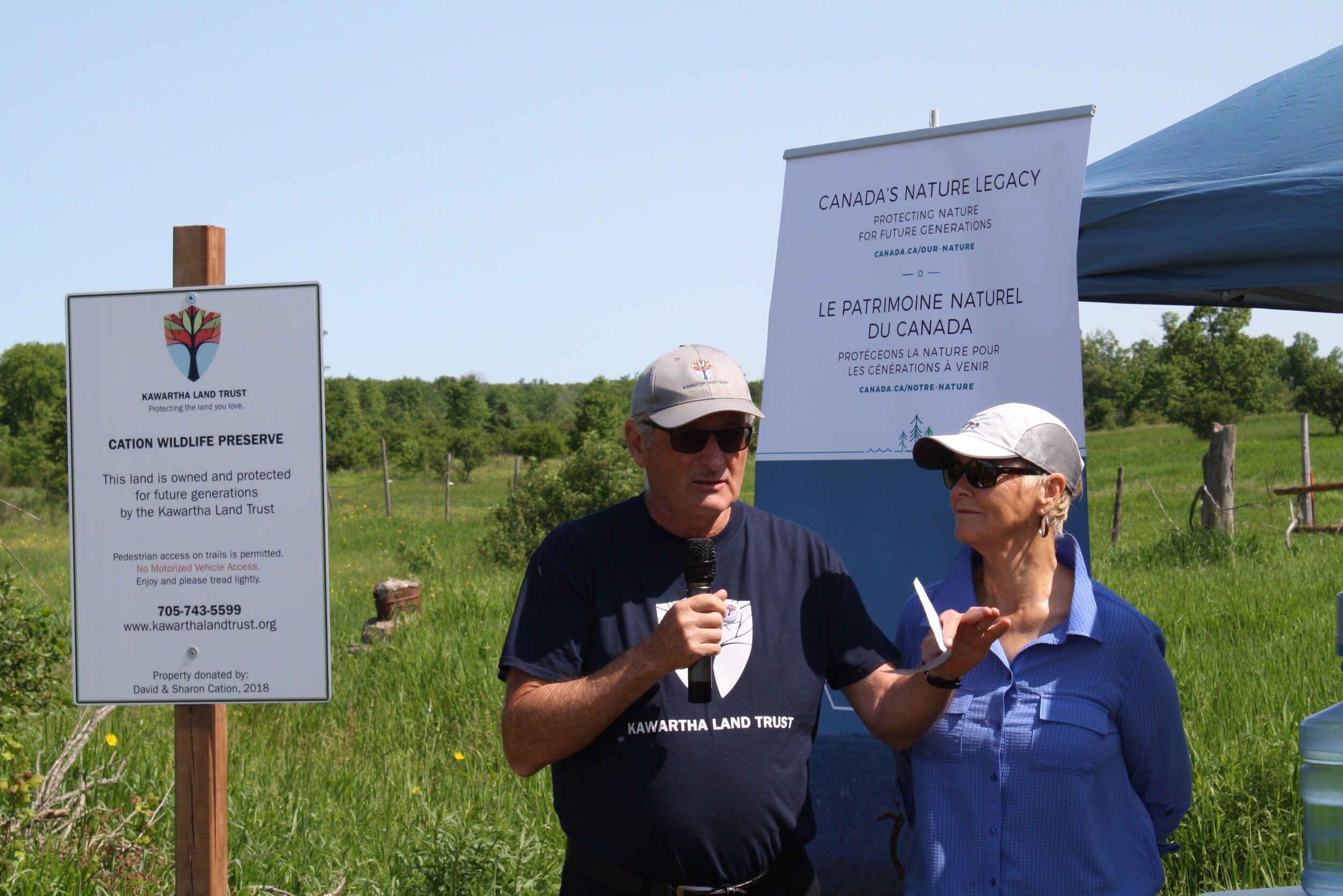 Dave and Sharon Cation address crowd at the grand opening of the Cation Wildlife Preserve