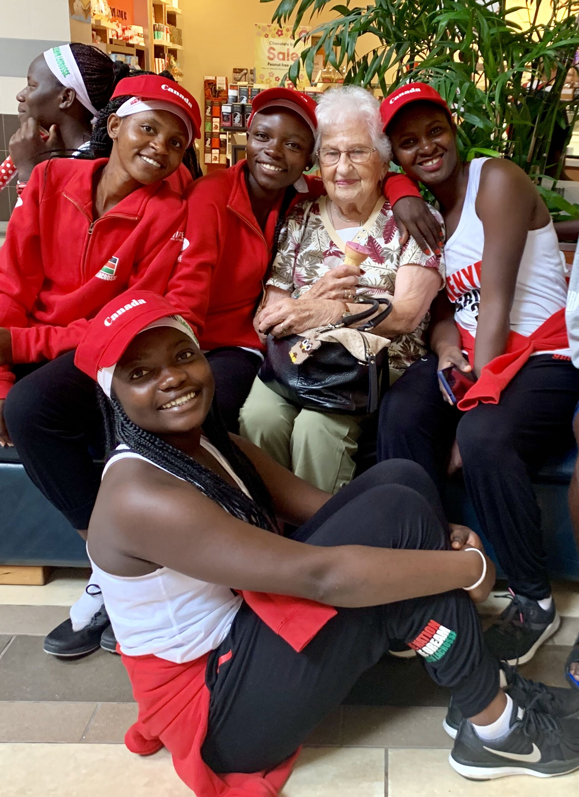 Kenya team members at Lansdowne Place with 101-year-old visitor from Cornwall. Ontario they met