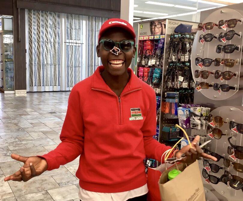 A beaming Maureen in her shades shopping at Dollarama. Maureen has 7 siblings back home.