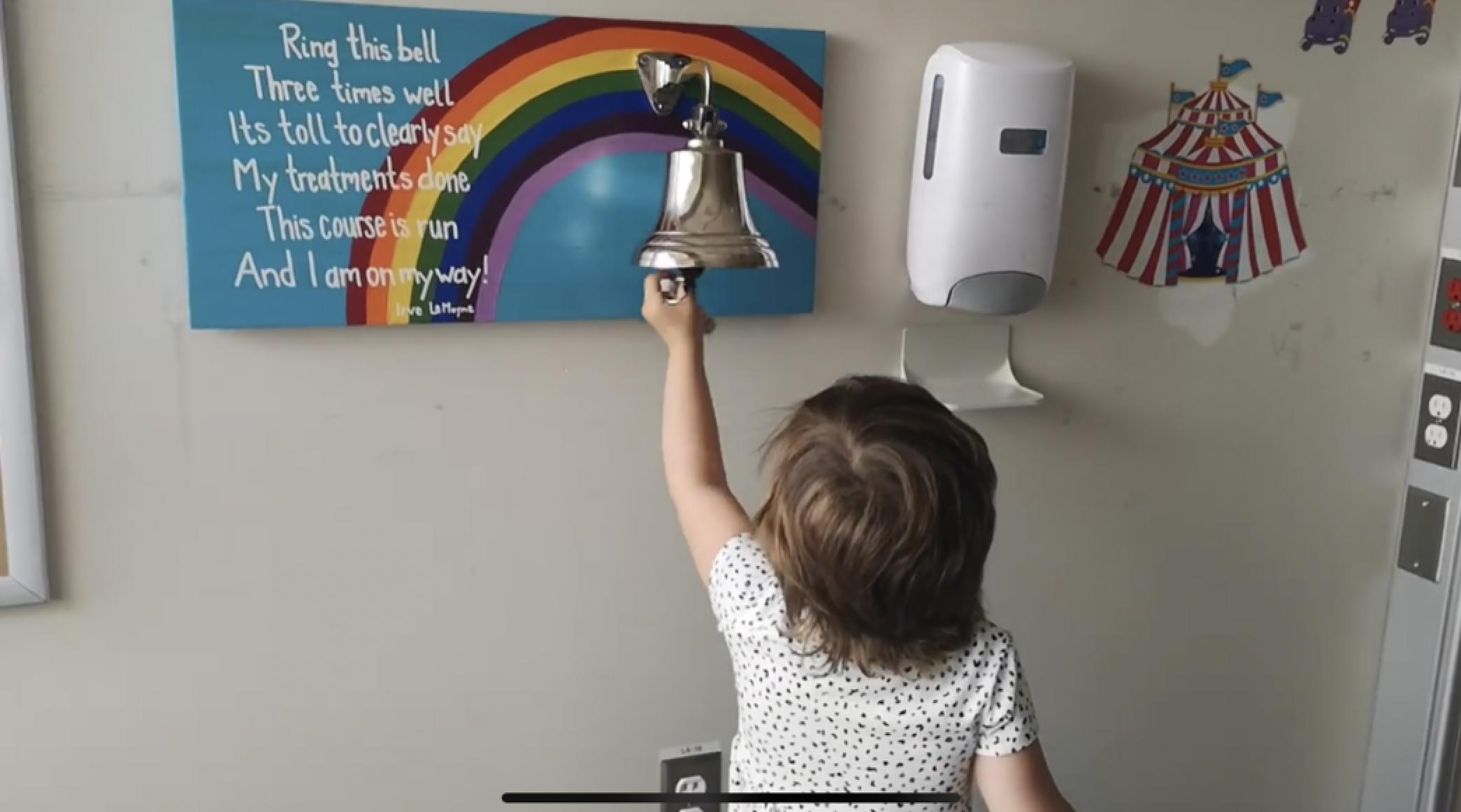 Harper ringing the bell