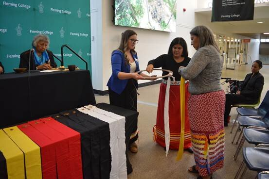 Natural Semaa wrapped in Tobacco Ties by Ashley Safar, Indigenous Student Services, Kylie Fox-Peltier, Manager, Indigenous Student Services and Elizabeth Osawamick. (Photo courtesy Fleming College)