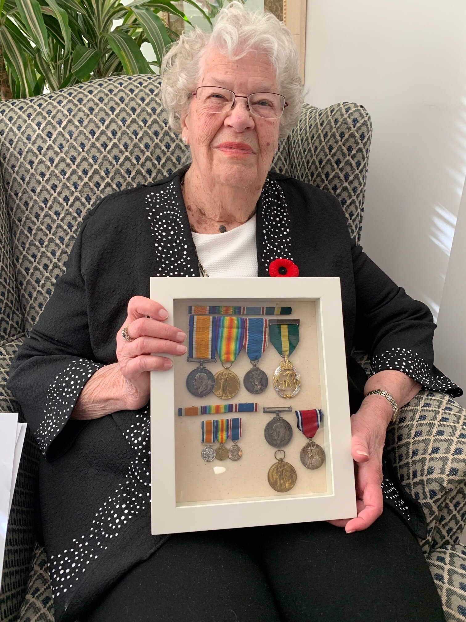 Catherine Allen with the found medals (photo by Neil Morton)