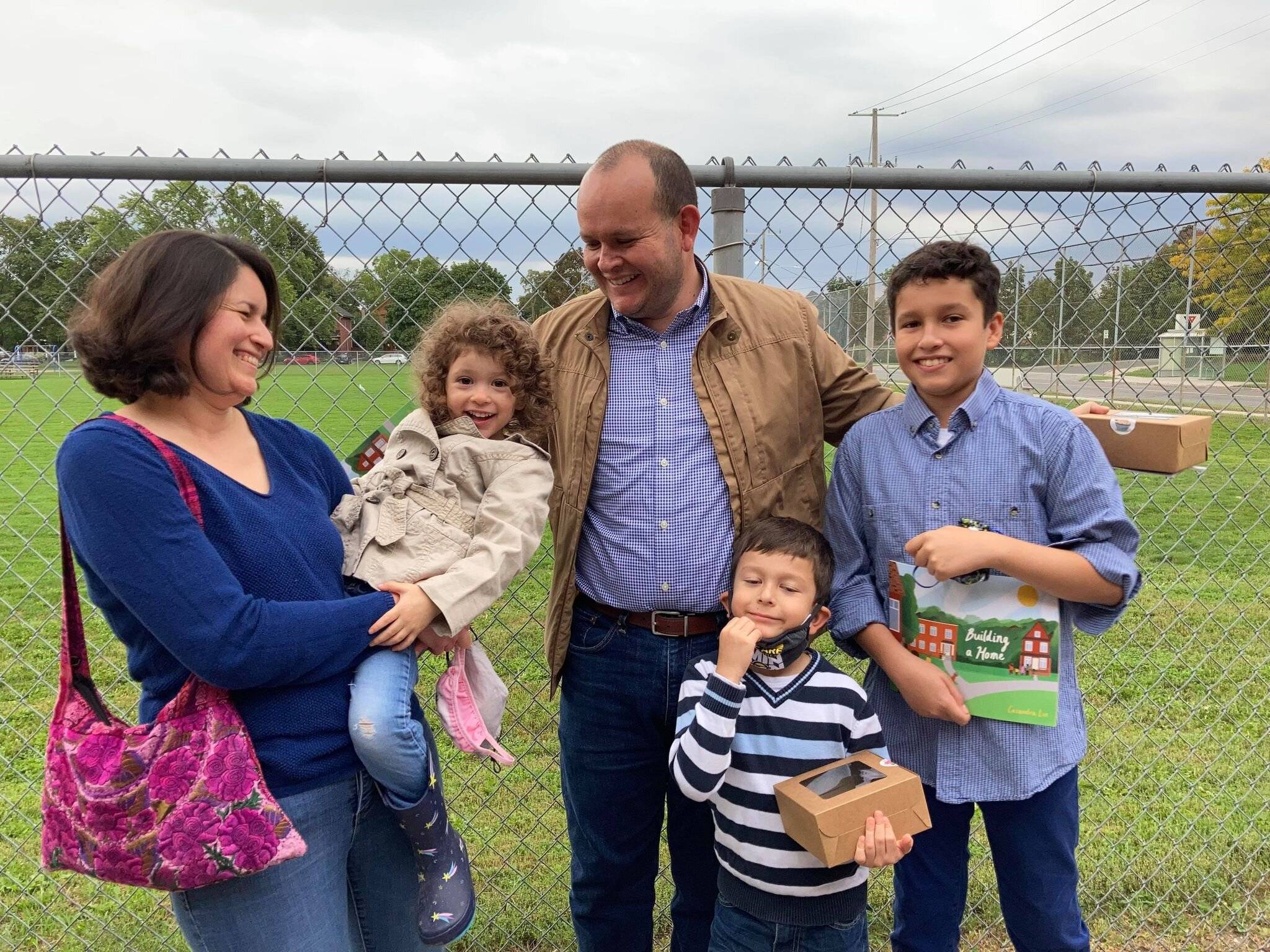 Jorge Escalera (far right), poses with his family at the book launch on Monday.  Escalera is one of six children whose story inspired Building a Home.  Photo by Angela O'Grady.