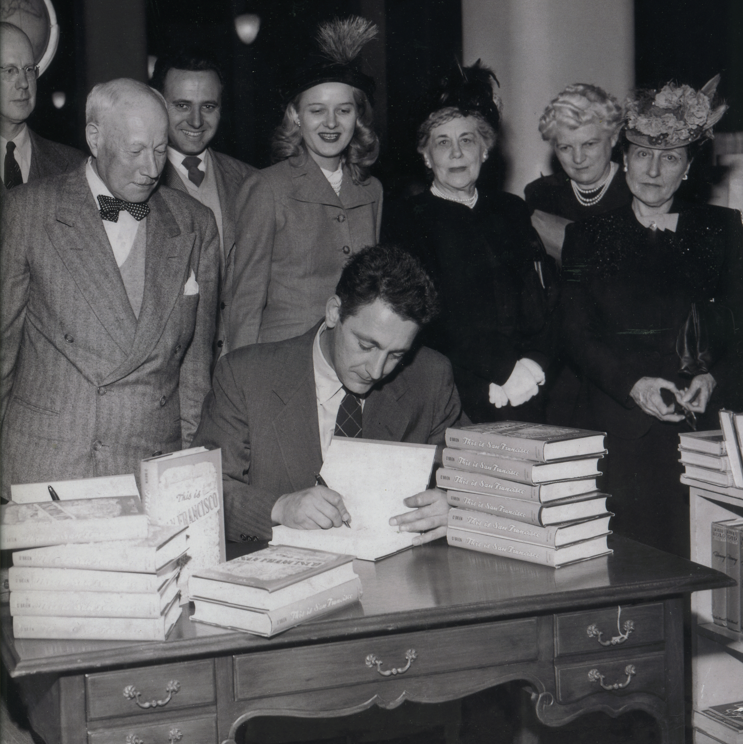 Robert O'Brien signing his book   This Is San Francisco  , circa 1950. Check out the hats—the ladies LOVED feathers!