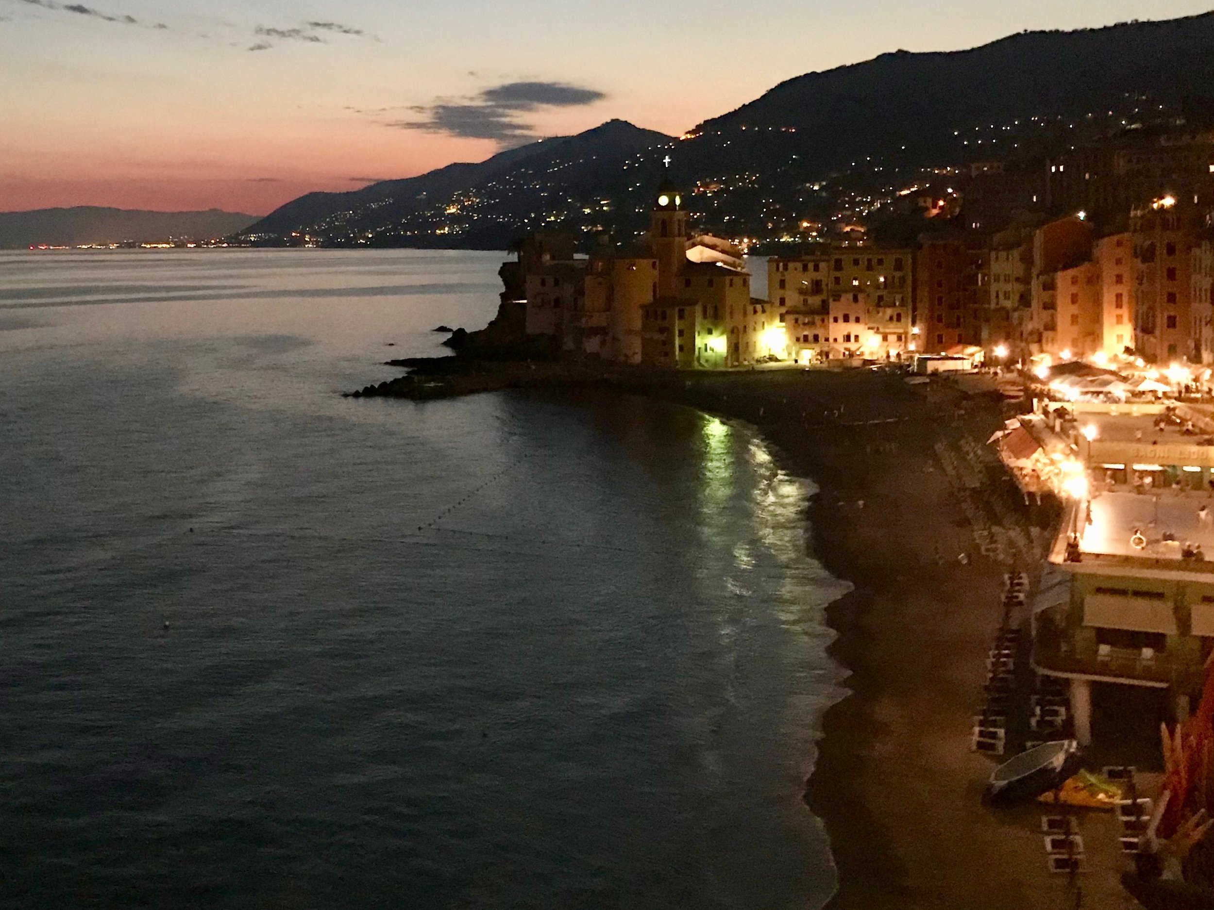 Camogli glows   under a setting sun