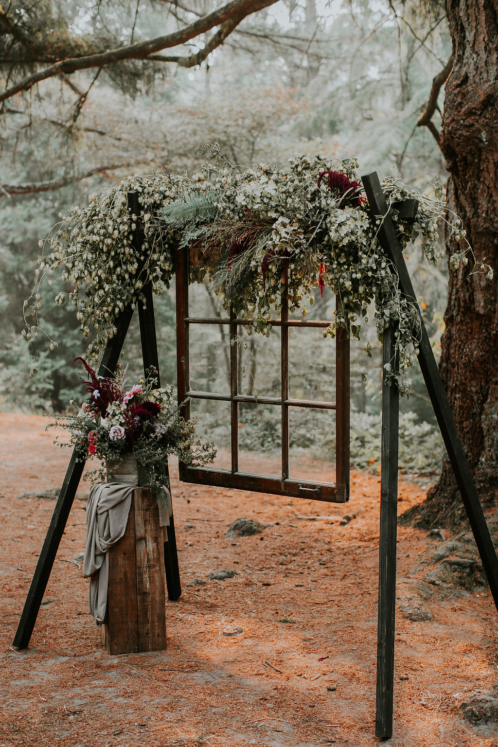 Woodland arch with hops and boho window