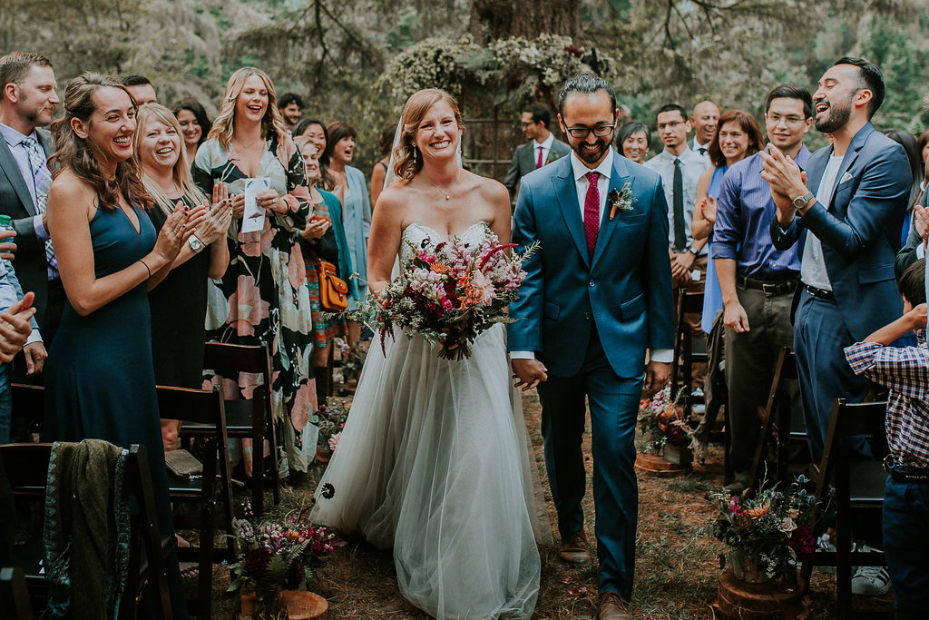 Jewel tone woodland aisle wedding flowers