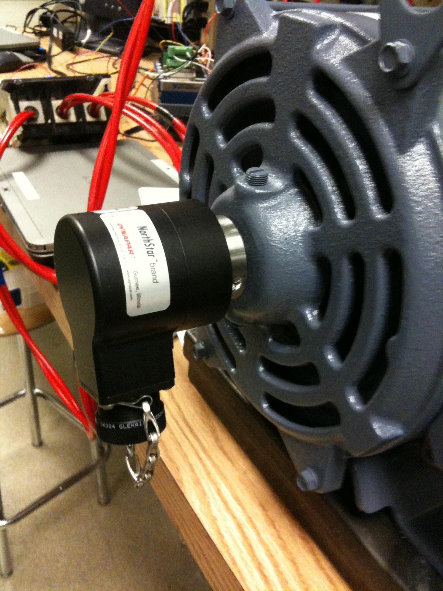 Dynapar optical encoder on secondary drive motor shaft