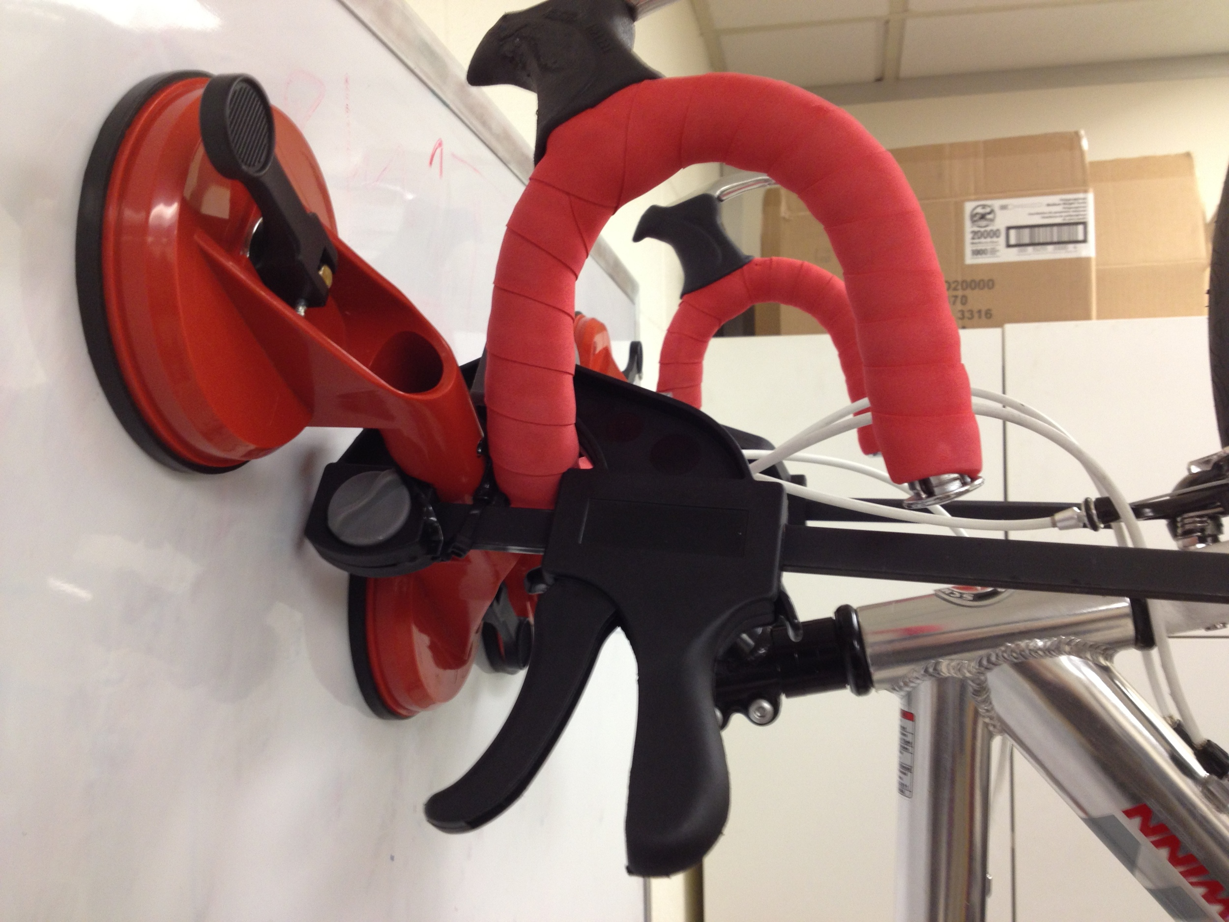 The early suction clamp mounting a bike to a whiteboard