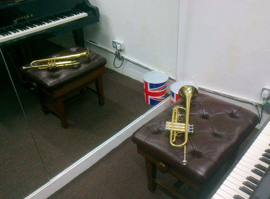 My trumpet with itsdoppelgängerand a worryingly symbolic waste paper bin.