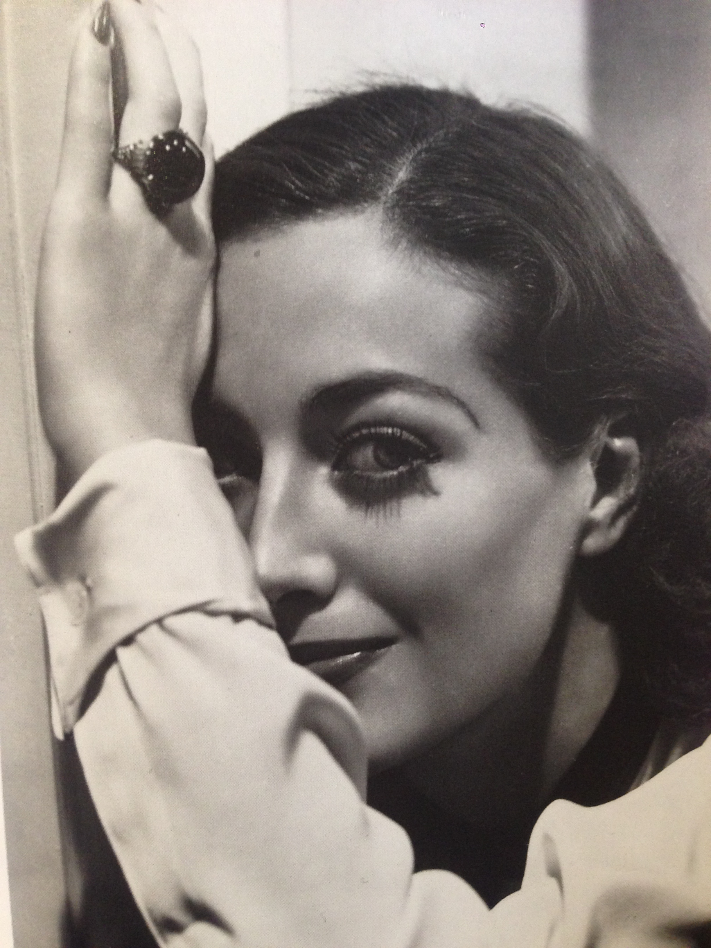 Joan Crawford loved jewellery, especially statement rings set with large gemstones.  In this photo, she is wearing a 72ct emerald-cut Sapphire.