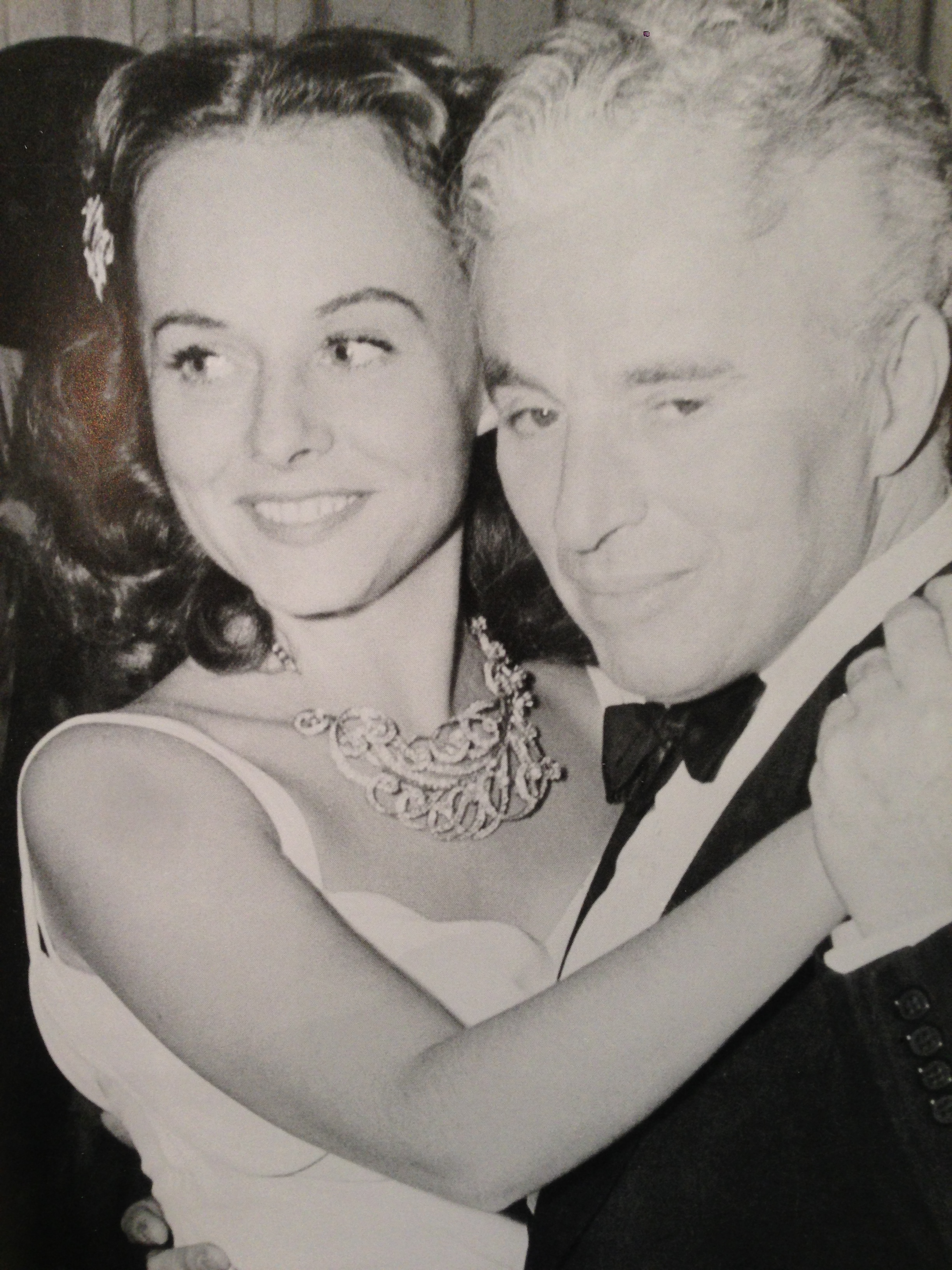 Gorgeous Paulette Goddard shown here with her husband, Charles Chaplin.  She was known for her collection of beautiful jewels.  This one is the Feather platinum necklace encrusted with diamonds.