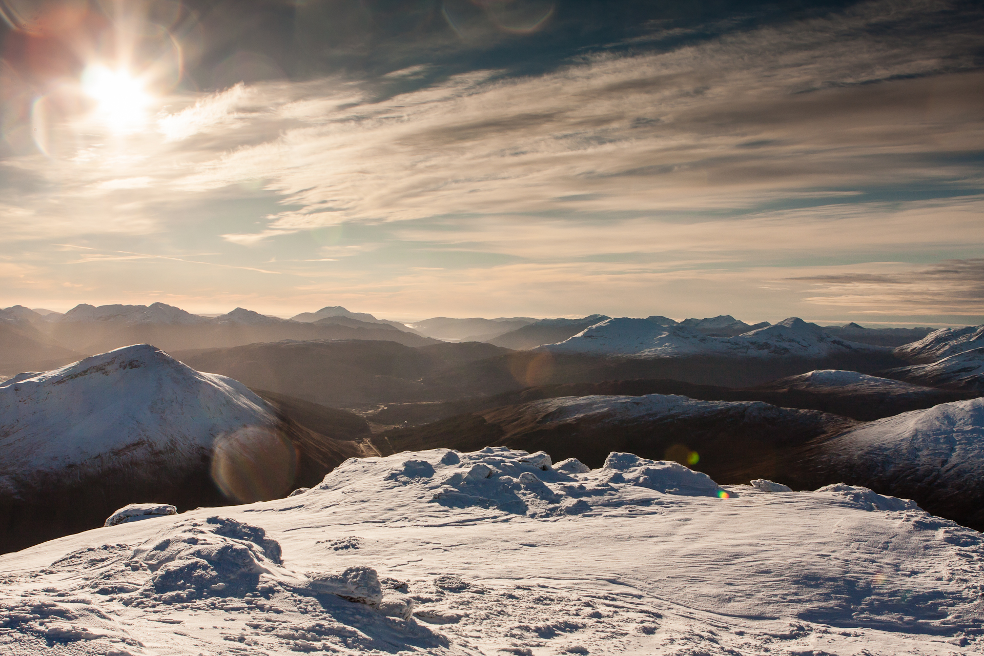 Looking south from Beinn Dorain on a glorious winter morning. An amazing sight to behold - but lens flared to buggery and beyond.
