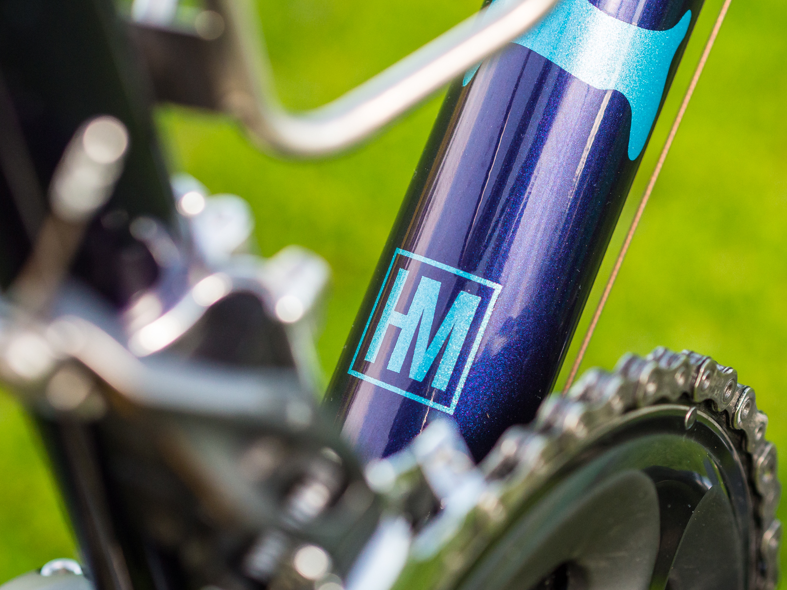 June 20. Technically, I took delivery of my Naked steel racer back in April, but it took a few months to collect the small parts I wanted to finalize the build. This shot captures the combination of stainless steel, turquoise, and burple flake when the sun hits the frame  juuuuuust  right.