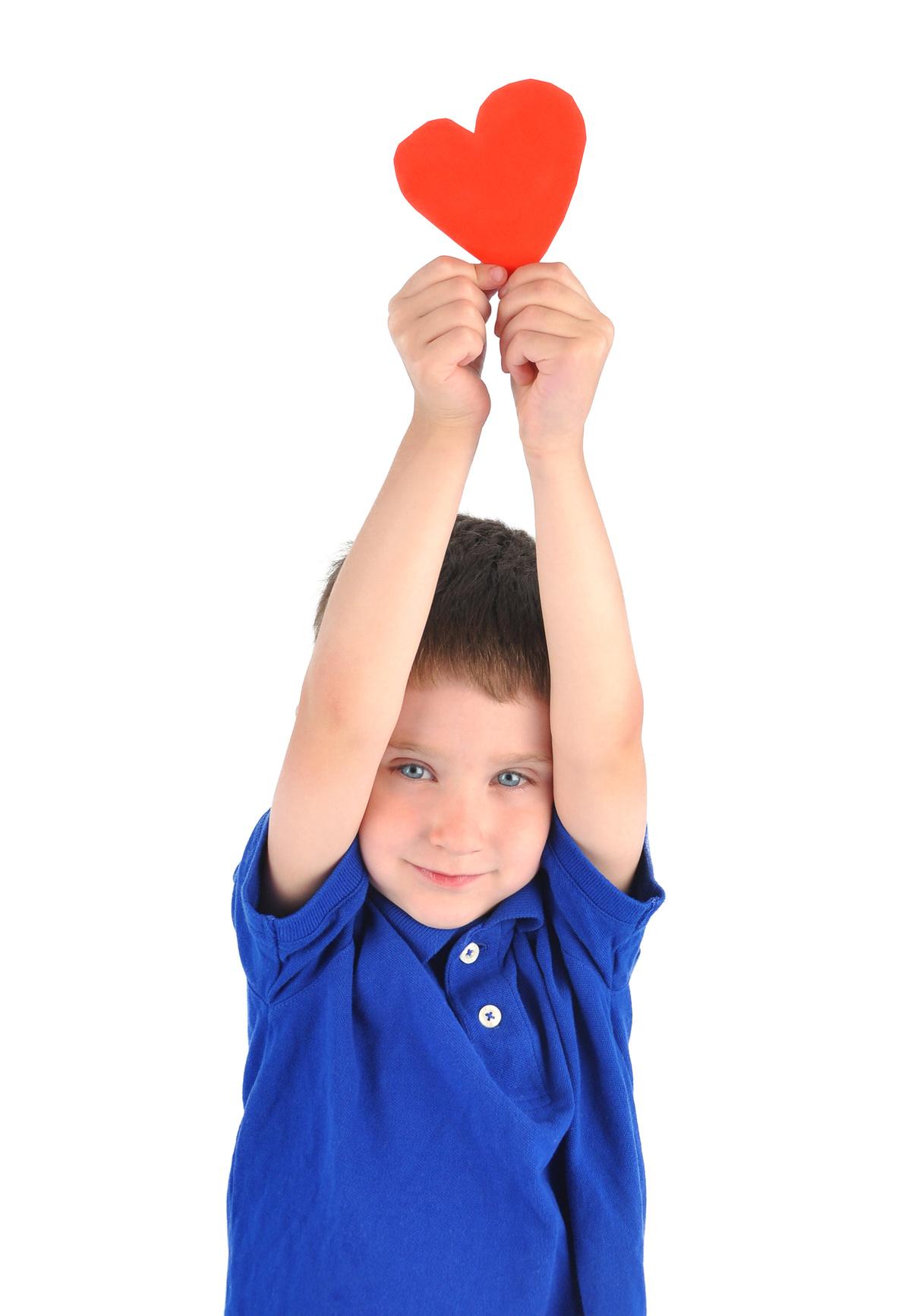 012604854-little-boy-holding-love-heart.jpeg