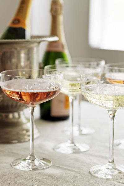 Some  legit crystal coupes  are SO much more festive than plastic disposables! (Plus, they're eco-friendlier. Win-win!)