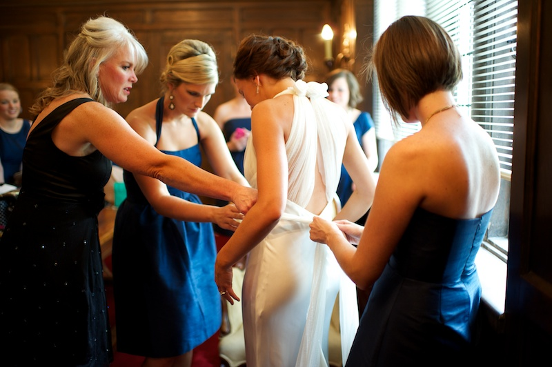 This mom-helping-her-daughter-into-her-dress moment wouldn't have happened if Mrs. Bartley was trying to set up centerpieces!  Glessner Photography .