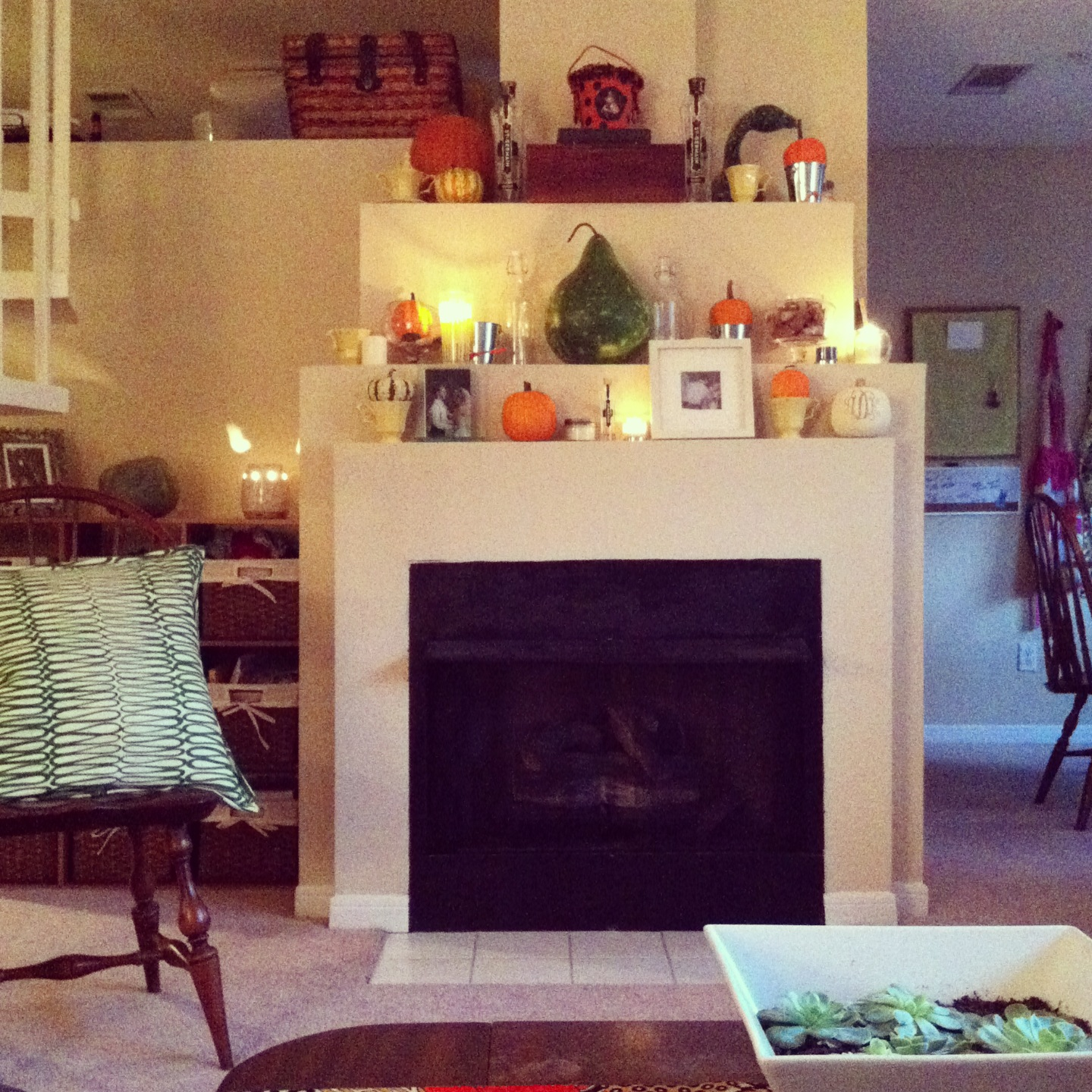 My fall 2013 mantle -- complete with gourds aplenty, softly glowing candles and a couple of romantic touches. It may or may not have been replaced yesterday by a verrrrry early Christmas display.
