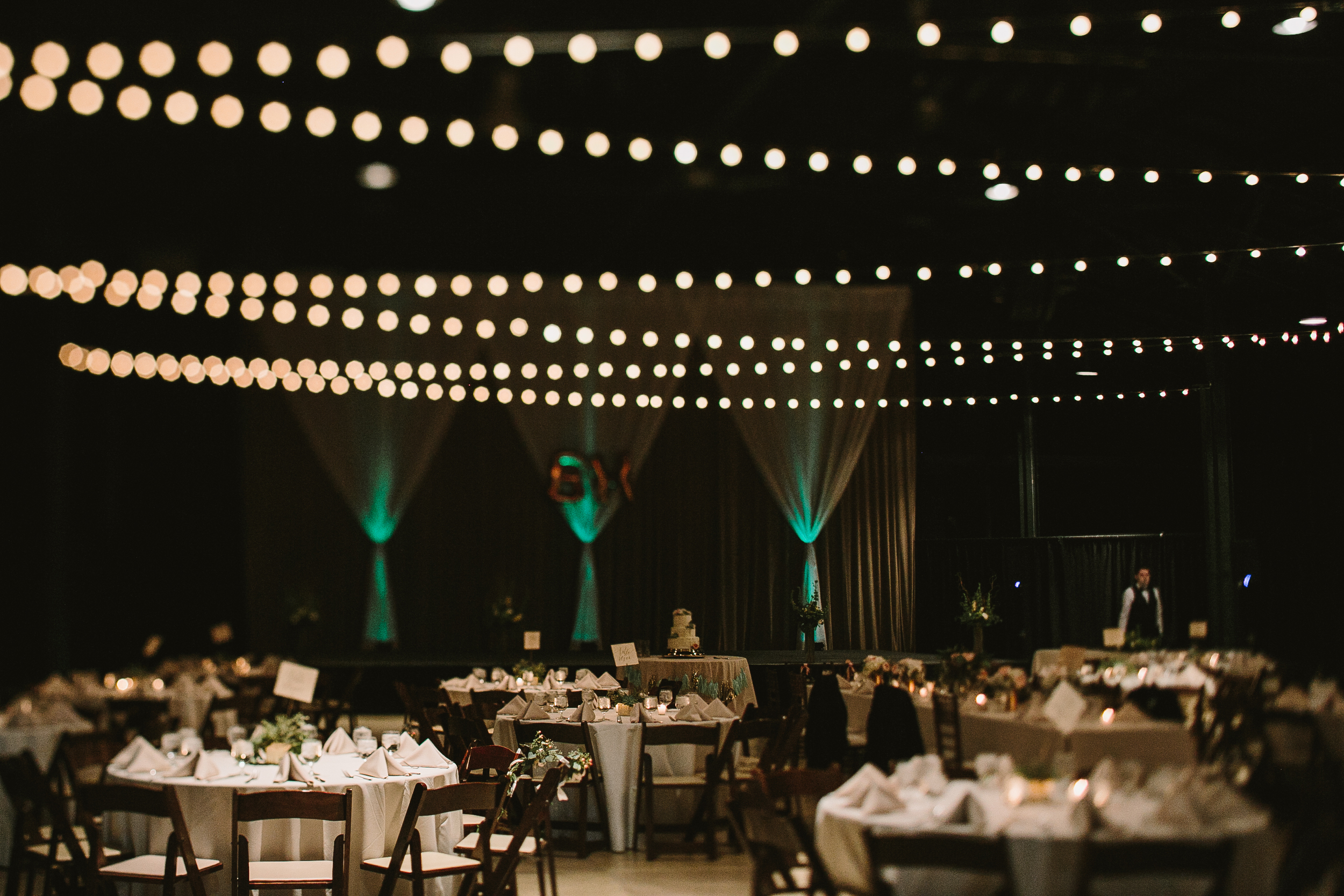 modern organic wedding reception string lights