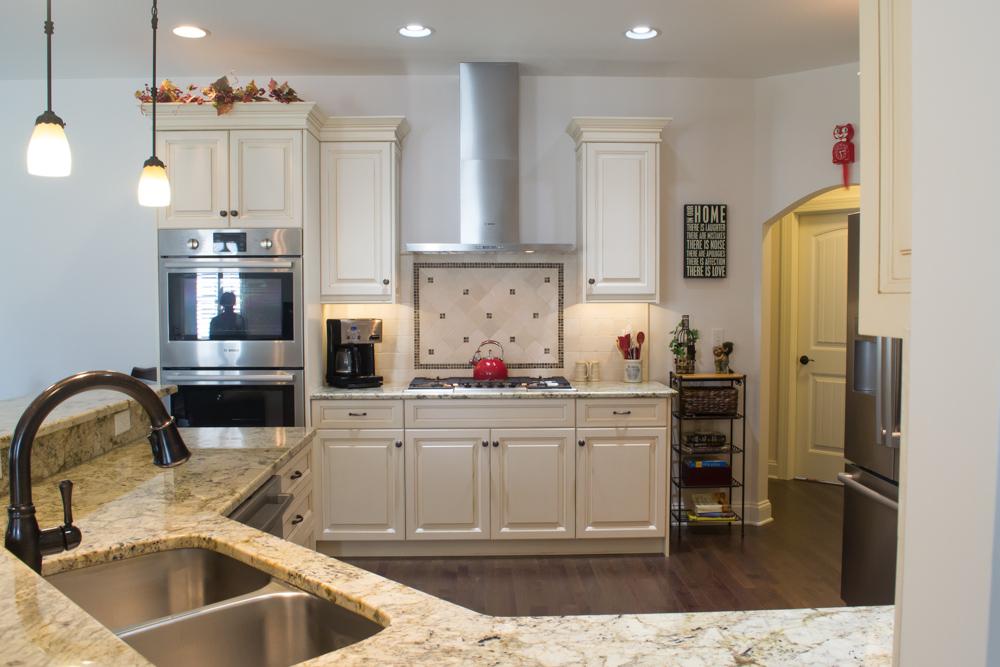 White painted custom cabinetry oyster glaze breakfast bar -7.jpg