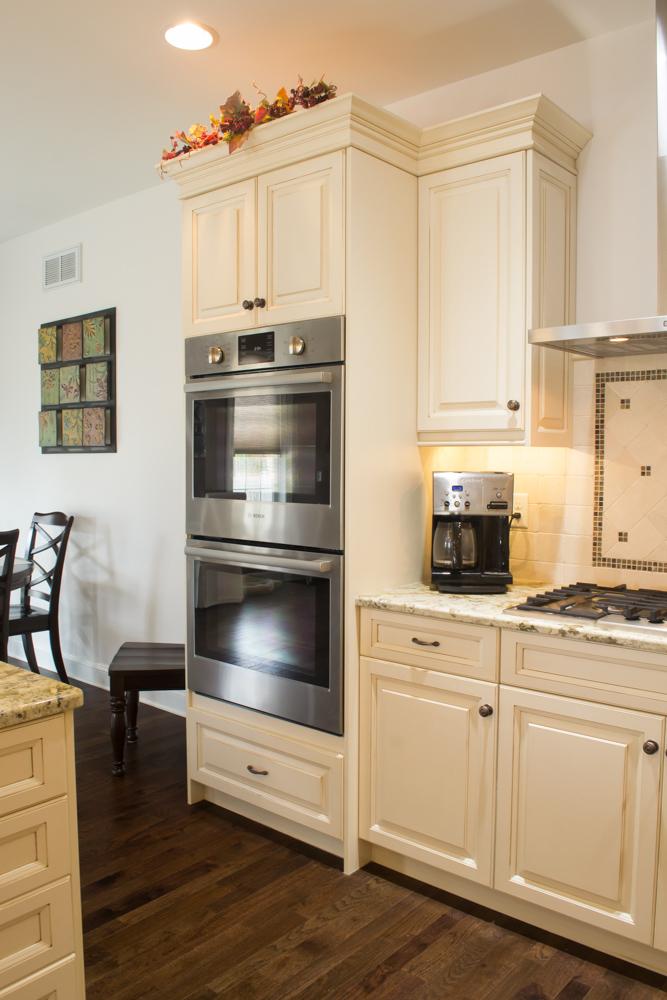 White painted custom cabinetry oyster glaze breakfast bar -10.jpg