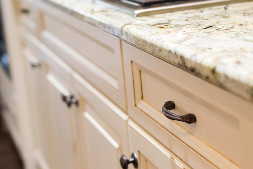 White painted custom cabinetry oyster glaze breakfast bar -18.jpg