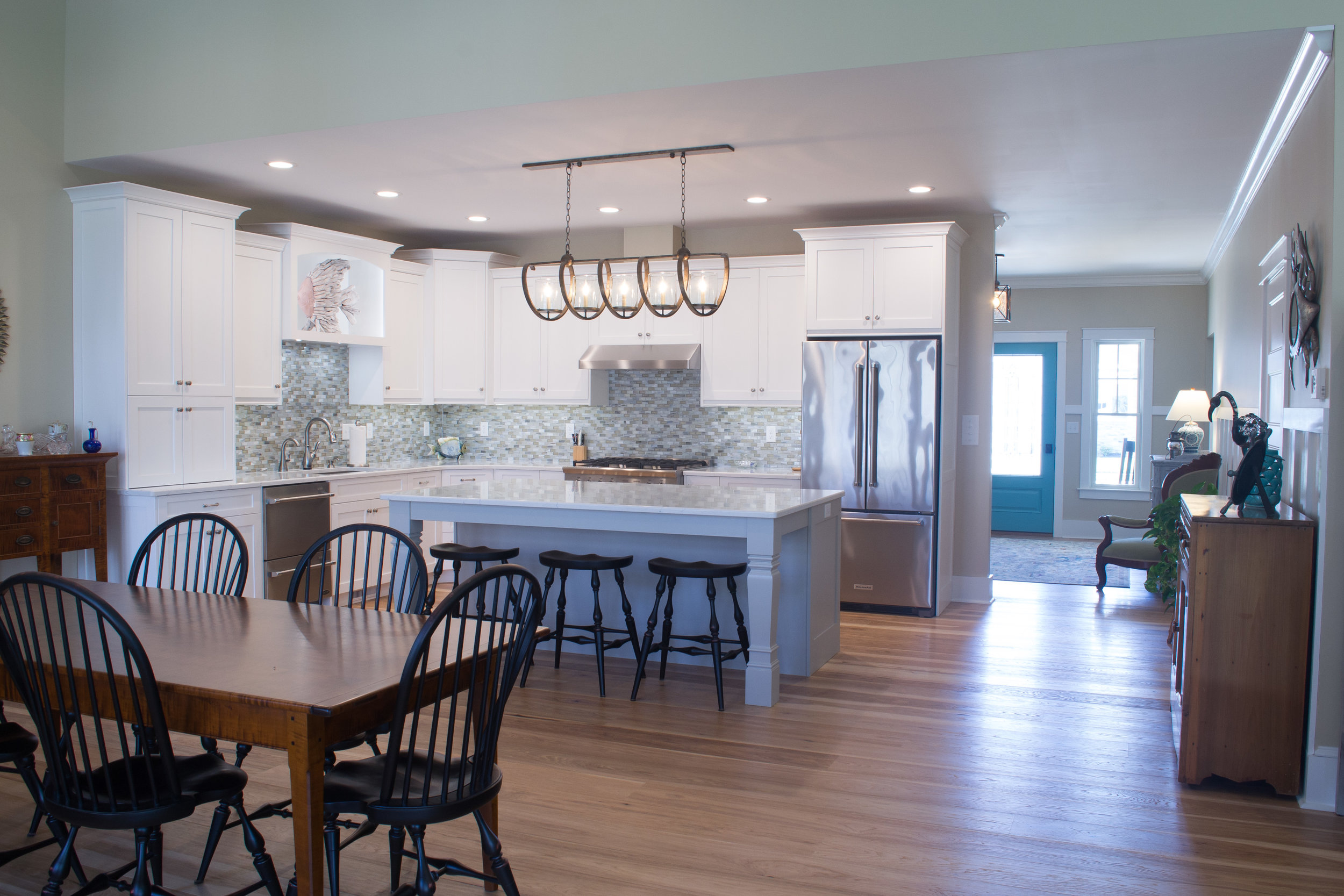 White painted kitchen with grey island