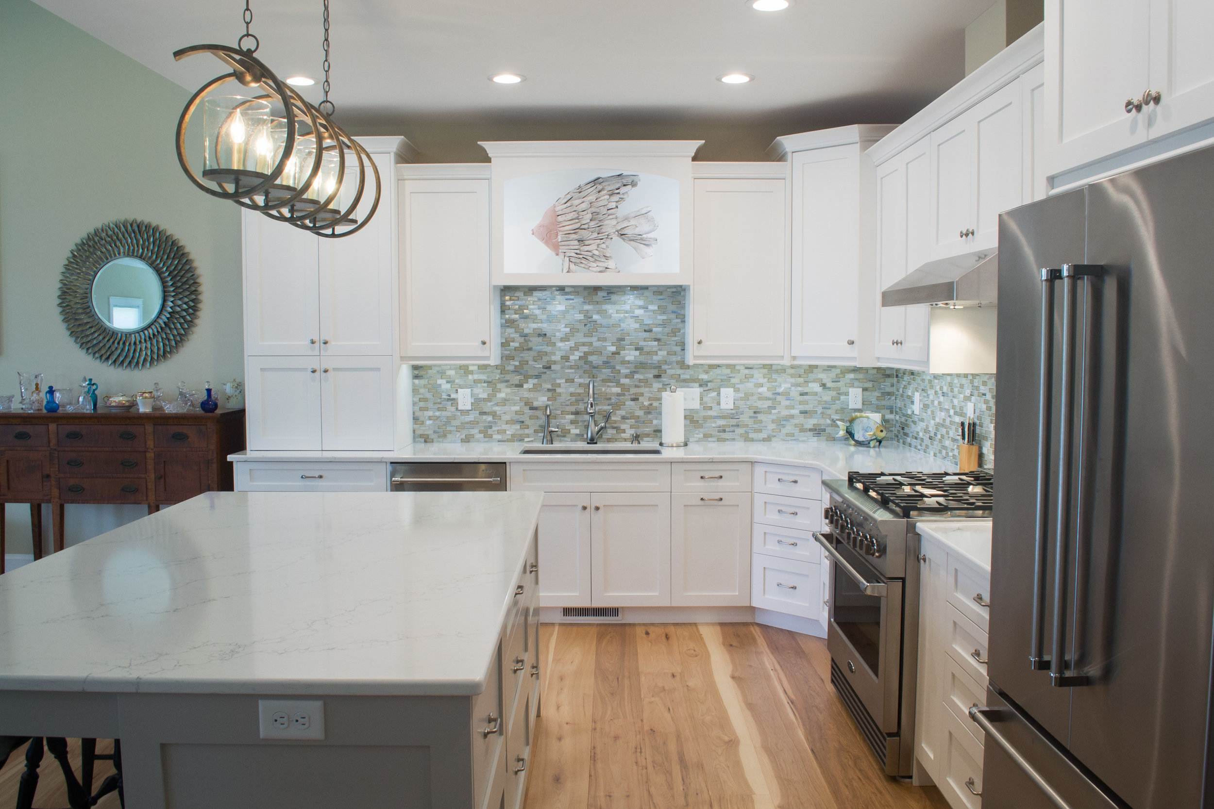 White painted kitchen with grey island in Lewes, DE