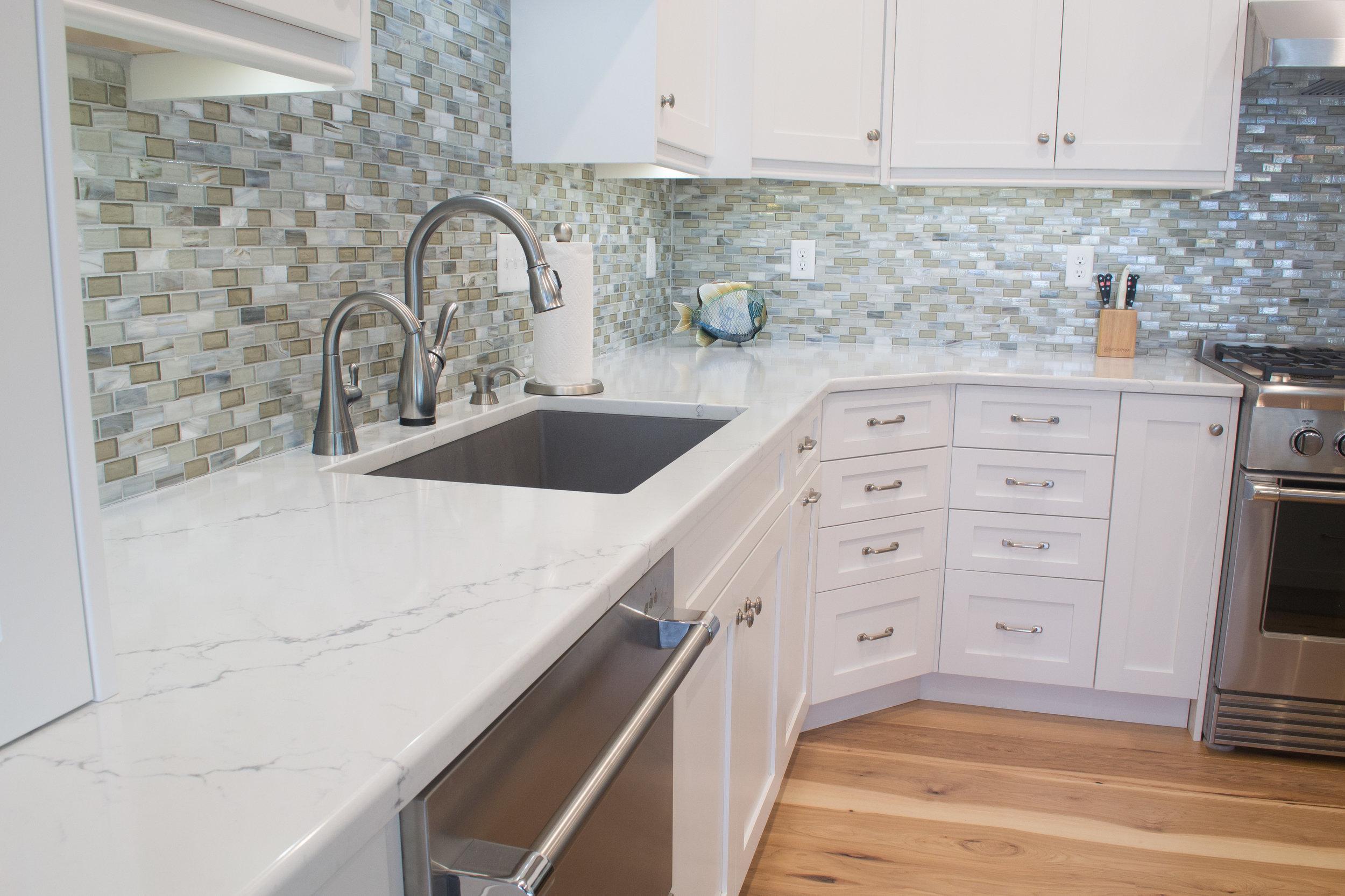 White custom painted kitchen with custom corner drawer stack