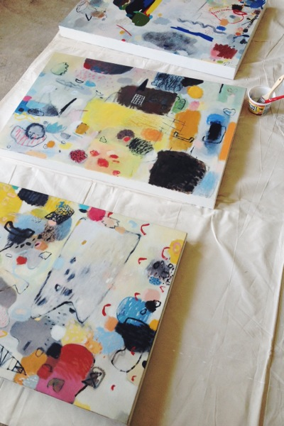 Cleaning up the edges of these canvases, prepping them for a gallery.