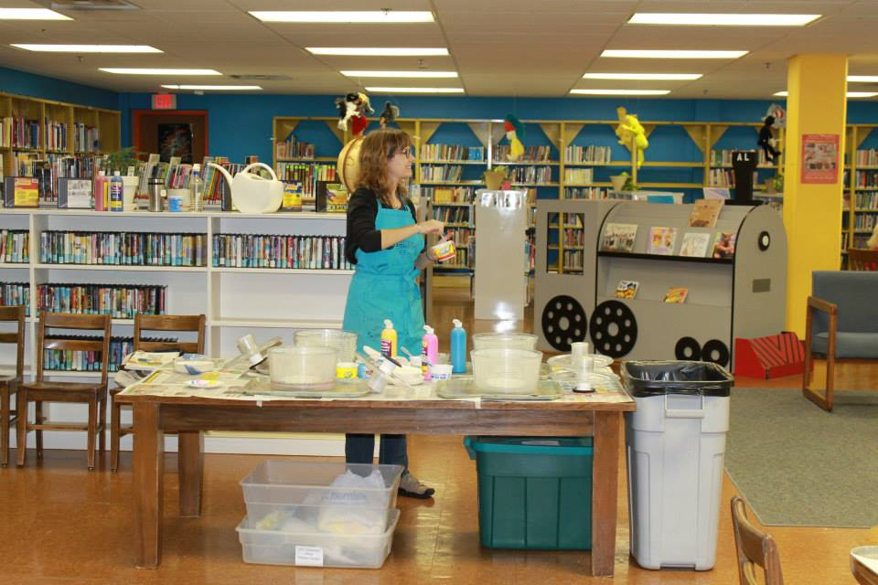 Here I am mixing paint for the spinner art project. (Photo by Atchison Public Library.)