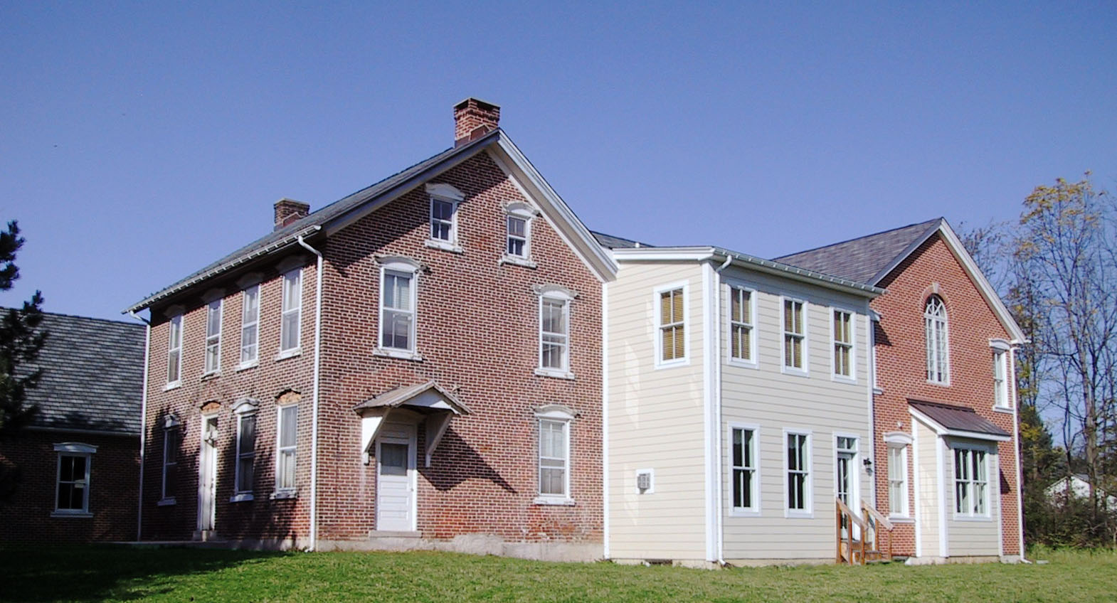 Existing Brick Farmhouse with addition to the right