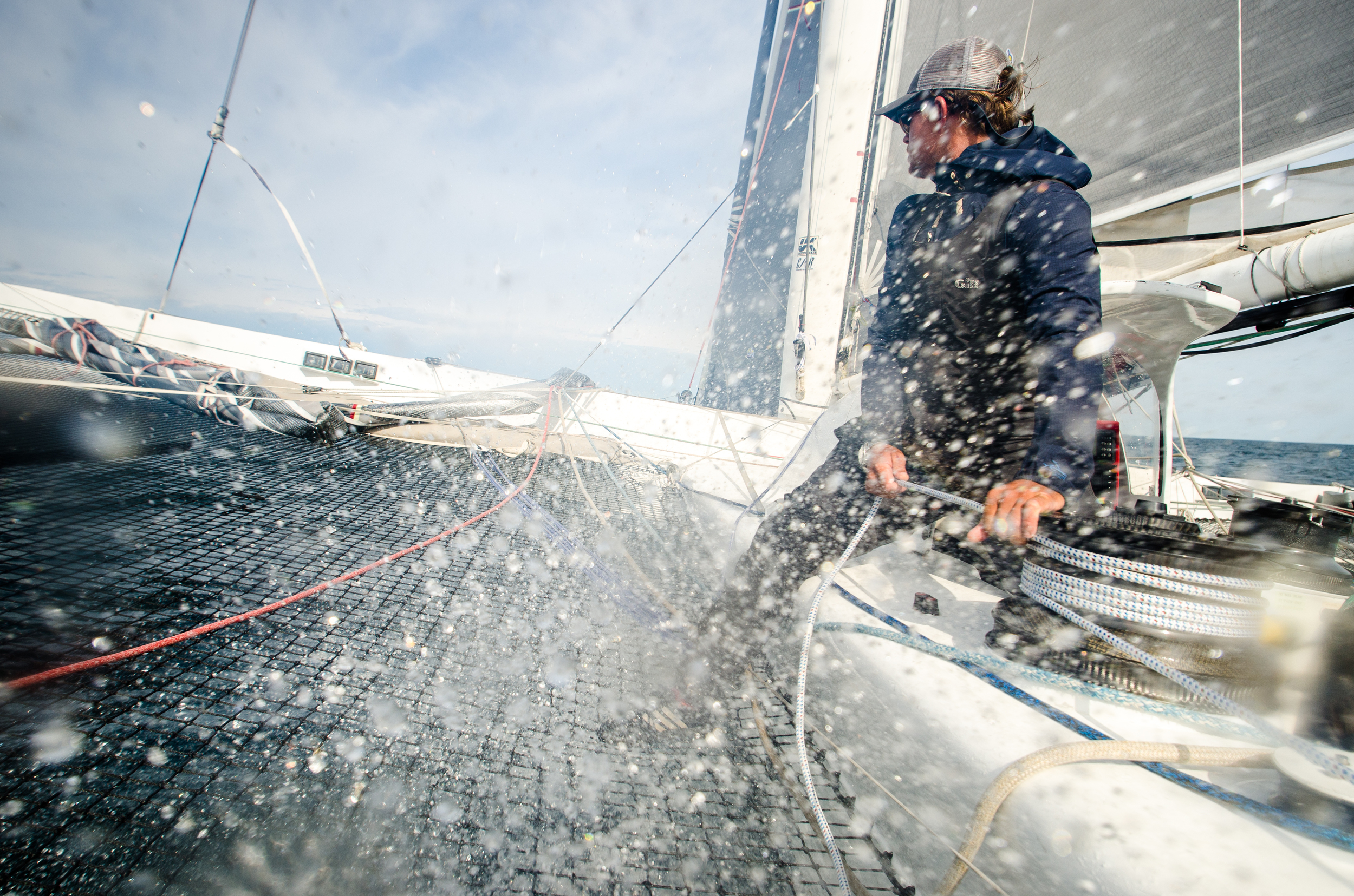 Donny takes a face full of spray as a wave hits the bow and pushes water up through the netting.