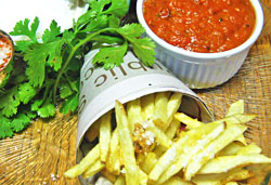 Hand-cut Fried Chips with Homemade Tomato Sauce  Photo : Jackie Cameron