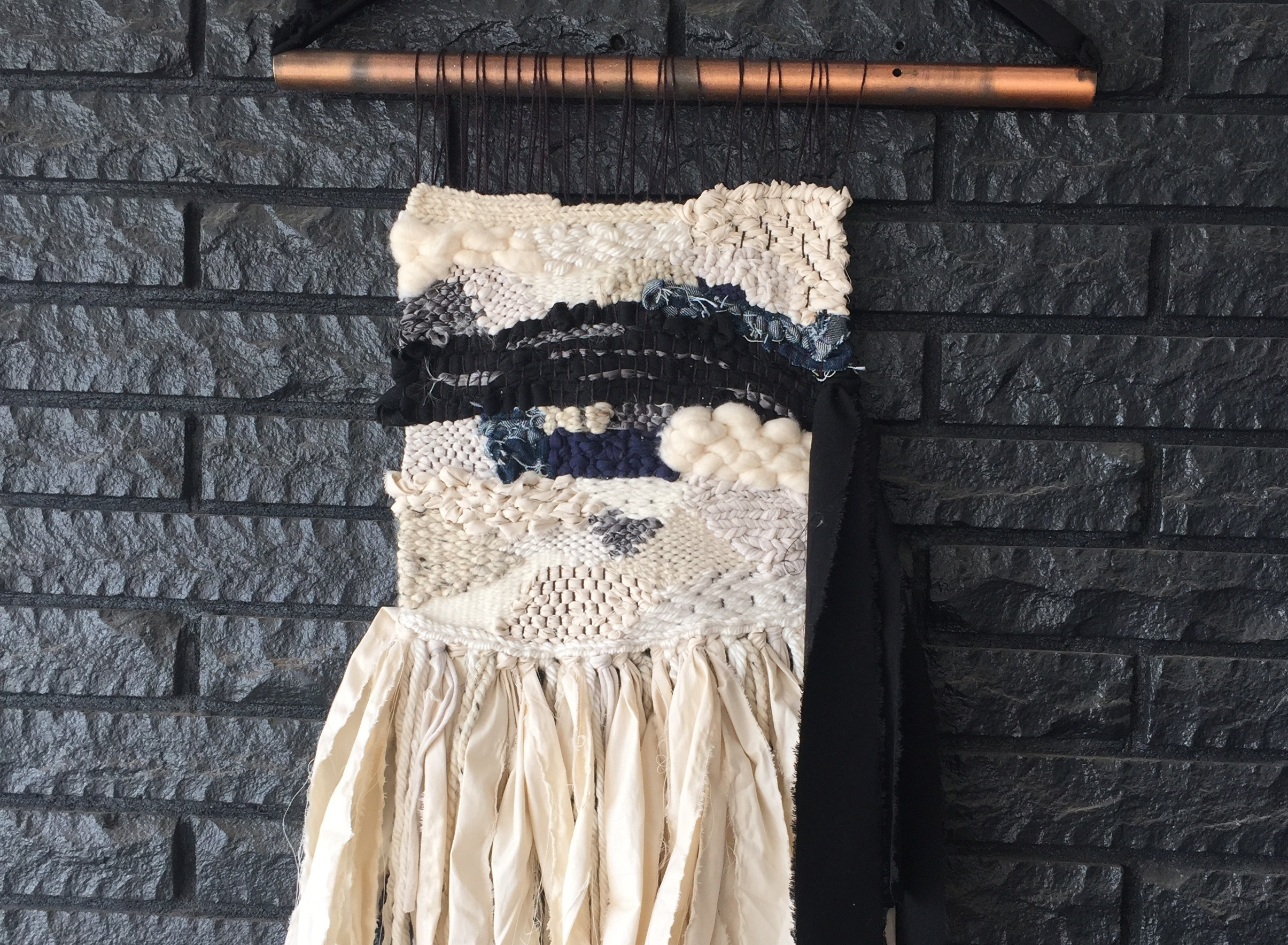 Handwoven tapestry made from recycled materials