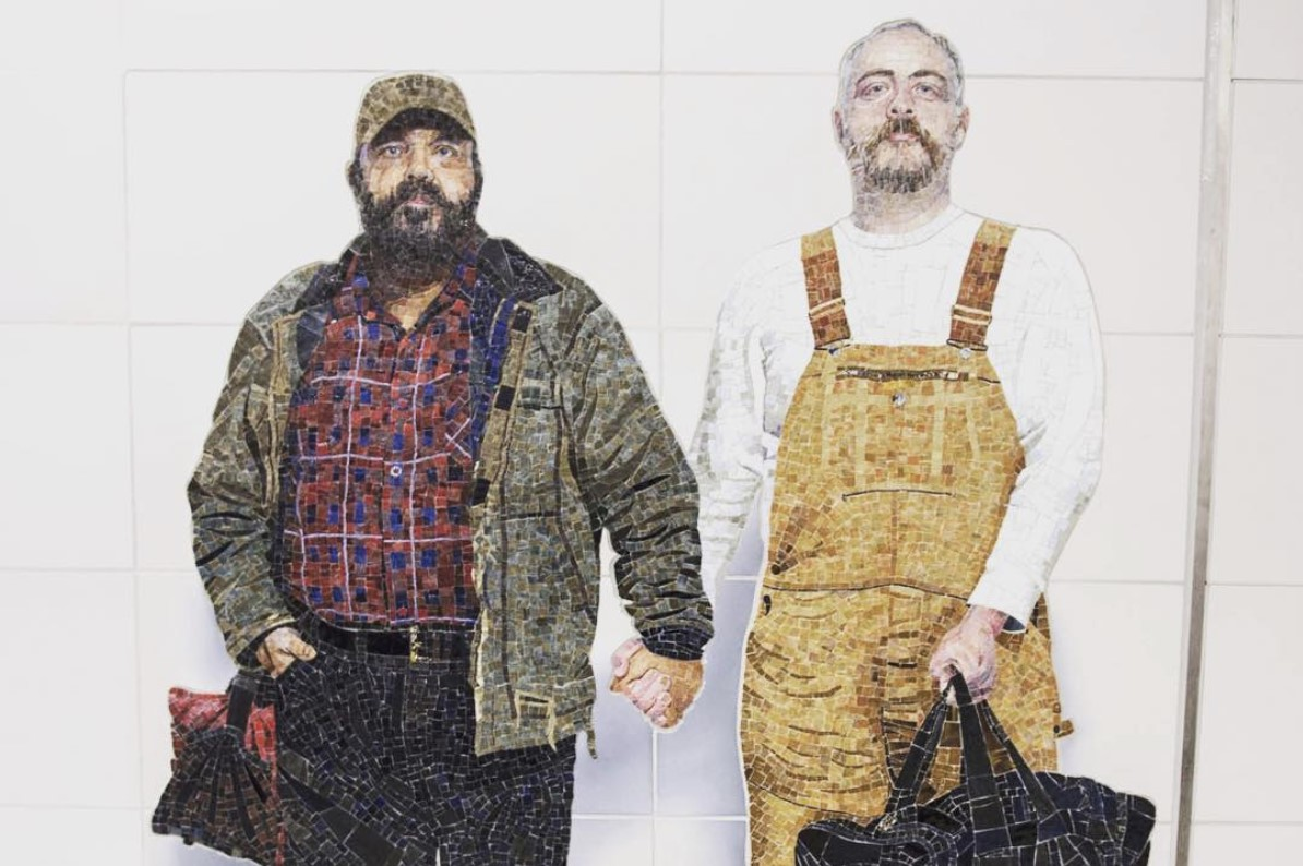 """Perfect Strangers"" by Vik Muniz. Muniz wanted to show normal people you see on the subway that you remember distinctly, but regard as a stranger. This image of a couple is said to be the first permanent LGBT public art in all of New York. It is located at 72nd Street Station."