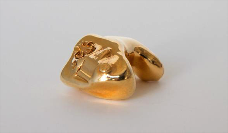 Sculpture: My Father's Hearing Aid Cast in Gold by Neil Goldberg, 2012