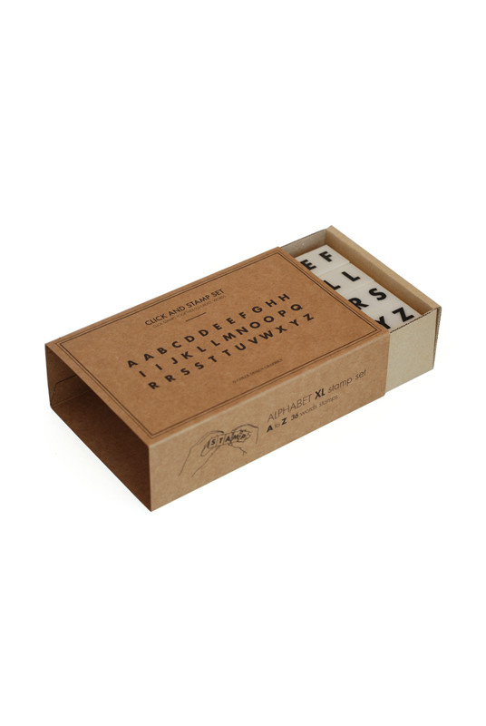 NoteMaker -  O-Check Design Graphics Stamp Set - Futura Alphabet, $18.68 .  The letters click together for perfect alignment.